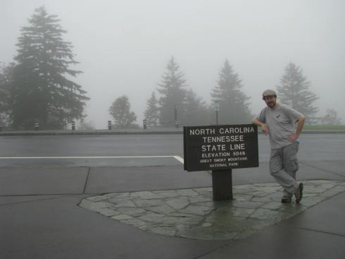 Posing near a famous sign in the Great Smoky Mountains.