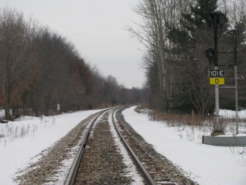 Railroad tracks in winter are beautiful.